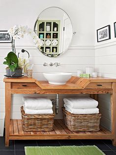 Refinish a flea market find, update an existing stock cabinet, or upgrade a retail table for a personalized vanity you& love. Let these stylish ideas for a DIY bathroom vanity be your inspiration. Bathroom Vanity Makeover, Rustic Bathroom Vanities, Wood Bathroom, Vanity Sink, Wood Vanity, Bathroom Wainscotting, Wainscoting Height, Black Wainscoting, Wainscoting Nursery