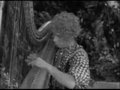 Harpo Marx in Horse Feathers [1932]  Harpo was a serious harpist for all his clowning in the movie role he adopted.