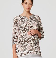 d74b37044a With its flowy fit and ethereal floral print, this blouse is effortlessly  bohemian-cool. Split neck. 3/4 blouson sleeves with button cuffs.