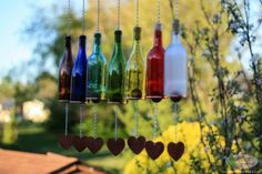 """Got some empty glass bottles hanging around the house? You can reimagine this """"garbage"""" into some really stunning, useful crafts for your home."""