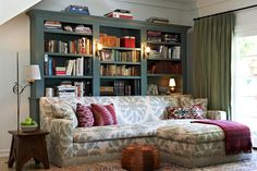 built-in bookcase + muted colours + patterns in eclectic living room design by Kristen Panitch Interiors