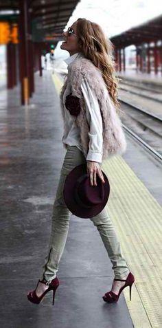 pink faux fur vest. cranberry shoes. jade zipper pants.