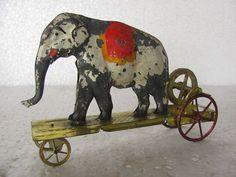 Rare early elephant fly wheel penny tin toy, France