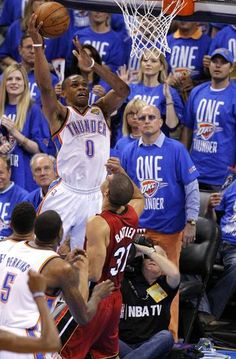 Oklahoma's Russell Westbrook (0) dunks over Miami's Shane Battier (31) during Game 1 of the NBA Finals between the Oklahoma City Thunder and the Miami Heat at Chesapeake Energy Arena in Oklahoma City, Tuesday, June 12, 2012. Photo by Sarah Phipps, The Oklahoman