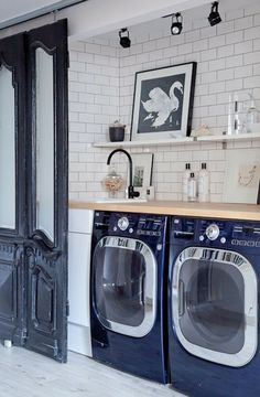 Blue Glam: Talk about a glamorous laundry room. Sleek, minimalistic decor is the ideal complement for bold, blue appliances. Somehow the room looks both modern and vintage at the same time. (via Style Me Pretty).. 20 Swoon-Worthy Laundry Rooms…Yep, Laundry Rooms via Brit + Co.