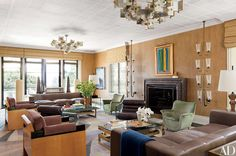 In this Kelly Wearstler–designed living room in Bel Air, California, vintage wall lights salvaged from a Roman cinema flank the fireplace; the leather sofas are by J. Robert Scott.
