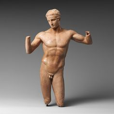 Terracotta statuette of the Diadoumenos (youth tying a fillet around his head) | Greek | Hellenistic | The Met