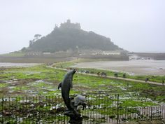 MARAZION:  St. Michael's Mount in Cornwall, the sister isle of Normandy's Mont St. Michel, and the causeway at low tide https://destinationfiction.blogspot.ca/2016/10/coastal-marvels-of-cornwall.html