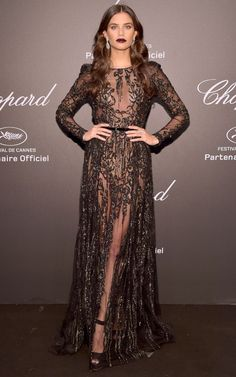 Best Dressed Stars on Cannes Red Carpet 2017  SARA SAMPAIO      The model picked a sheer long-sleeve black gown and accessorized with diamond earrings for the Chopard Space party. She vamped up the look with a bold burgundy lip.
