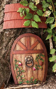 I bet I could make this fairy door out of wood, plastic or what ever I find in the house and some paint. My Grandbabies would get a kick out of it.