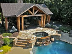 brownstone focal point.  Cool decking with brownstone border??? Also like wood beams