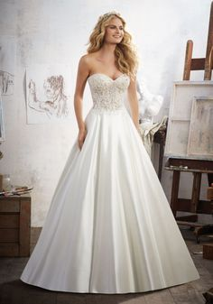 2017 Wedding Gowns and Bridal Dresses by Morilee. Stunning Lace, Net and Satin Wedding Dress with Crystals on the corset style bodice and a flowing skirt.
