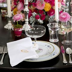 """Mix Formal and Casual China  Feel free to mix and match dinnerware, from casual everyday styles to your more traditional wedding china. Add a modern touch to your place settings with large crisp linen napkins embellished with a graphic monogram.  Family silver is an important part of Charleston table settings and Tara says """"don't stash it away."""" She advises to keep it easily accessible and ready to be used, and then to use it all the time."""