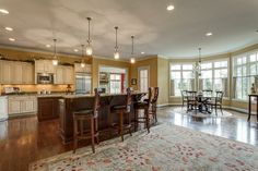 Open kitchen and living room space -- with big farmhouse table instead of round table