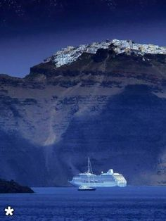 A cruise ship under Fira town in Santorini island, Greece. - Selected by www.oiamansion.com