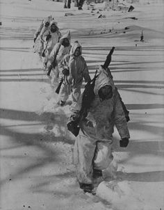 """Spanish volunteers of the Wehrmacht 'Blue Division' (or """"División Azul"""") brave the harsh elements during the Siege of Leningrad. February, 1943. The Nationalist's victory in Spain's bloody civil war was made possible thanks to the Reich's support. After war broke out between Germany and the USSR in 1941, over 40 thousand Spanish Nationalists enthusiastically joined German ranks to aid in the fight, though Spain's neutrality forbade them from engaging Allied forces ."""