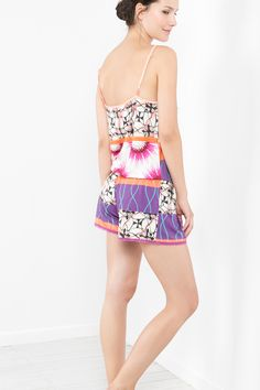 This cute multi-print jumpsuit is perfect for those hot summer nights...