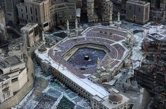 An aerial view shows Muslim pilgrims walking around the Kaaba in the Grand Mosque of the holy city of Mecca on August 6, 2012