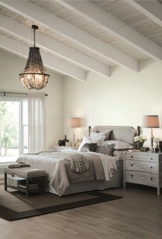 The neutral Alabaster, Sherwin-Williams' 2016 color of the year, sets a tranquil mood in this naturally inviting bedroom.