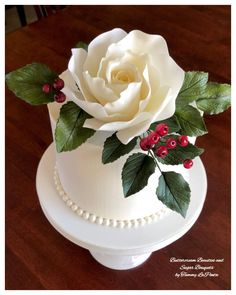 This was the elegant rose cake I made for my mom's birthday! An Italian cream cake covered in Swiss Meringue Buttercream and adorned with a beautiful handmade ivory whimsical sugar rose, rose leave. Buttercream Wedding Cake, Cake Icing, Fondant Cakes, Cupcake Cakes, Cupcakes, Buttercream Roses, Gorgeous Cakes, Pretty Cakes, Amazing Cakes