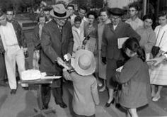 Former President Harry S. Truman hands out birthday cake to children for his birthday, May 8, 1956.