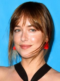 Shop Dakota Johnson's bright and on-trend tassel earrings here - great news, they're only $90.