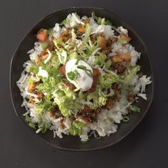 Recipe with video instructions: How to make Japanese Taco Rice  Ingredients: 1 Tbsp vegetable oil, 3 cloves garlic, minced, 1 cup onion, chopped, ½ lb tofu, crumbled, ½ lb cooked quinoa, 3 Tbsp soy sauce, 1 Tbsp chili powder, 1 tsp ground cumin, 1 tsp salt, 1 tsp freshly ground black pepper, 4 cups steamed Japanese rice (sushi rice), 2 cups lettuce, shredded, 2 cups tomatoes, chopped, 2 cups shredded vegan mozzarella cheese or queso blanco, 1 cup salsa, 4 Tbsp vegan sour cream, Chopped green…