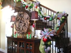 Garland on stairs @ http://kristenscreationsonline.blogspot.com/2009/11/hey-guys-ive-been-busy-this-is-clients.html