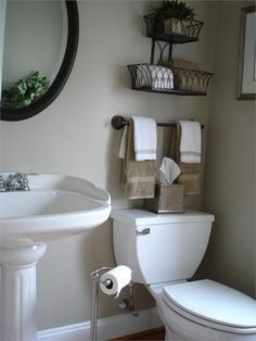 Creative Bathroom Storage Ideas   Shelterness Decorative garden planters for towel storage Neat idea