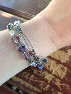 This one-size-fits-all memory wire bracelet features purple iridescent beads and a dangle heart charm. Sales benefit RAINN  https://www.rainn.org/  RAINN (Rape, Abuse & Incest National Network) is the nations largest anti-sexual violence organization. RAINN created and operates the National Sexual Assault Hotline (800.656.HOPE, online.rainn.org y rainn.org/es) in partnership with more than 1,000 local sexual assault service providers across the country and operates the...