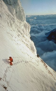 Perhaps the best shot ever taken of mountaineers on K2. These are legendary American mountaineers Ed Viesteurs and Scott Fischer on the deadly traverse on K2 just above the Bottleneck. This part is the crux of the climb! Photo taken by Charley Mace during their climb in 1992.