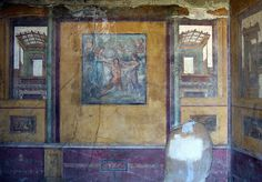 Fourth style wall paintings (from a room off the peristyle), House of the Vettii, Pompeii. House of the Vettii. Pompeii, Italy. Imperial Roman. c. second century B.C.E.; rebuilt c. 62–79 C.E. Cut stone and fresco.