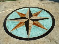 Compass Rose in the middle of the top of the end table. Concrete Patio, Concrete Floor, Backyard Patio, Stamped Concrete Designs, Painted Rug, Painted Furniture, Florida Decorating, Indoor Crafts, Stone Cladding