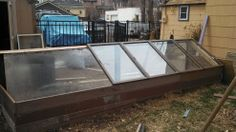Build an easy DIY cold frame with repurposed windows and a sliding door.