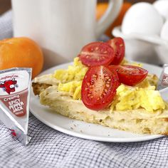 """""""Move over avocado, there's a new toast in town - The Laughing Cow Cheese Toast! Spread toasted bread with Spicy Pepper Jack then top with scrambled eggs, cherry tomatoes and a crack of black pepper. Devour, then dominate your day!"""" – @iowagirleats"""
