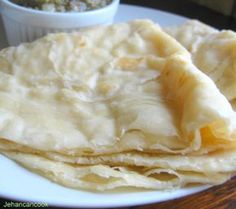 Roti 1 cup self rising flour 2 cups all purpose flour 1 1/4 cup water 1/4 tsp salt 3/4 cup oil 1/4 cup shortening