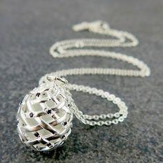 Weave Medium Egg Pendant With Black Spinel gemstones on the outside, and White Topaz rough gemstones on the inside.