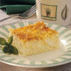 Dairy Kugel Recipe with egg noodles, butter, eggs, cottage cheese, sour cream, 2% reduced-fat milk, cream cheese, soften, sugar, vanilla extract, salt, ground cinnamon