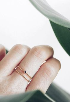 Our round diamond stacking ring is the perfect balance of simplicity and edge. Featuring a .03ct black diamond, bezel-set on a 14k gold band, this ring is easy to wear everyday and fun to stack with o