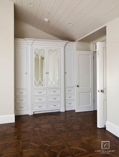 Slanted ceiling - Painted Built in Cabinets traditional bedroom
