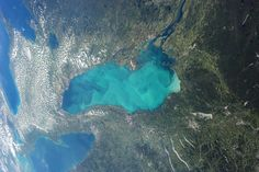 """NASA's views of Earth from space:Satellite Images of Earth A late-summer """"whiting event"""" visible across much of Lake Ontario.  CREDIT: NASA"""