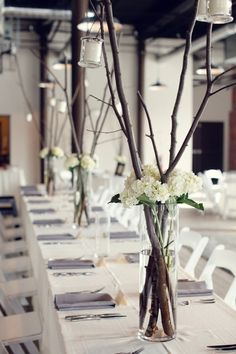 twigs-in-clear-vases - cute centrepieces for a summer party.