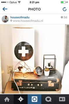 Bedside styling. Suitcases as tables. Interesting collection of accessories.