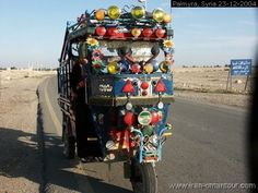 Colored tricycle car..... On the road near Palmyra Syria