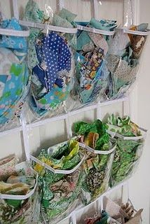 Hanging shoe organizer = scrap fabric storage! Easy to view and takes up little space :)