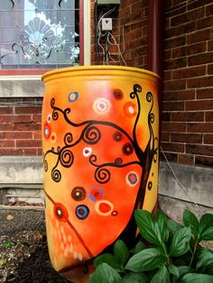 Rain Barrel paintings! Ok. An easy way to help the earth and save money. Yeah this is a no brainer for me!