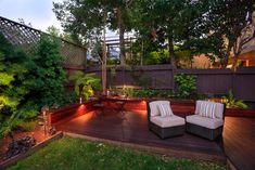 Platform patio/deck with small wraparound garden