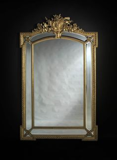 A Fine Louis XV Style Giltwood Marginal Frame Mirror with Bevelled Plates  French, Circa 1880.