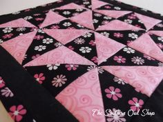 Pink and black pinwheel block small quilt by SouthernOwlShop