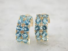 Bright Blue Topaz Hoop Earrings, Perfect for Day or Evening 934E6C-D by MSJewelers on Etsy https://www.etsy.com/listing/247333581/bright-blue-topaz-hoop-earrings-perfect